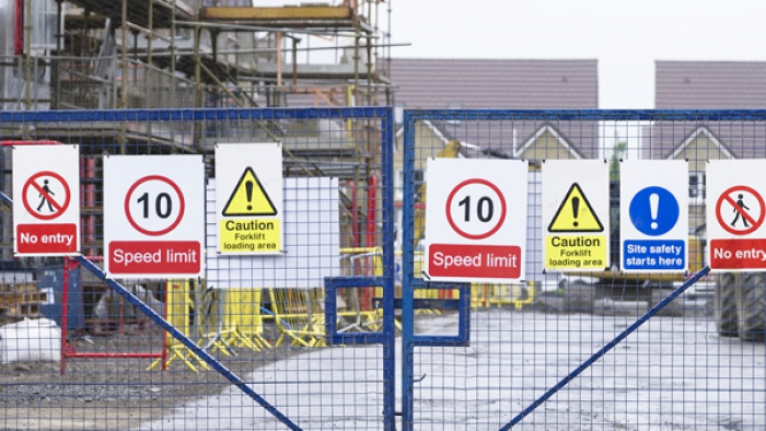Entrance to building site with signage