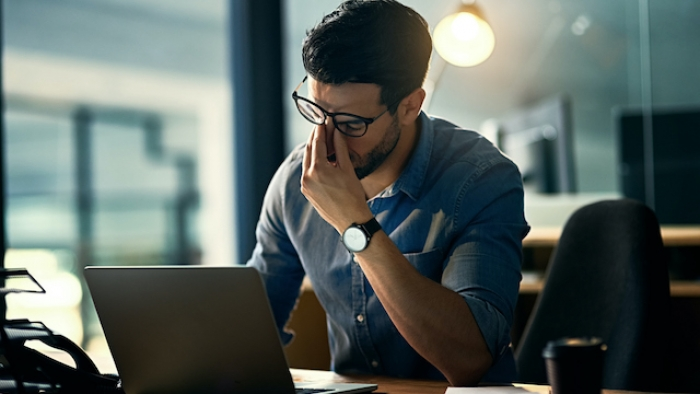 Man suffering from working stress