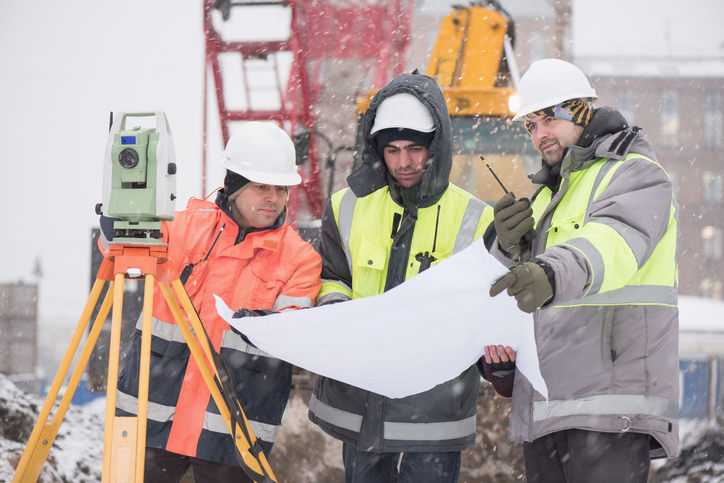 Civil Engineers At Construction Site In Winter