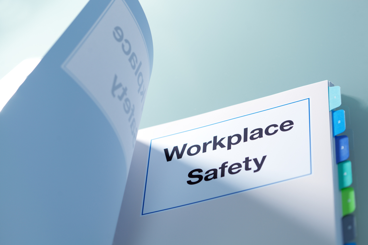 "Tabbed manual titled ""Workplace Safety"""