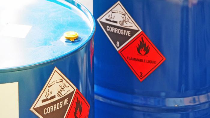 the close-up shot of blue color hazardous dangerous chemical barrels.