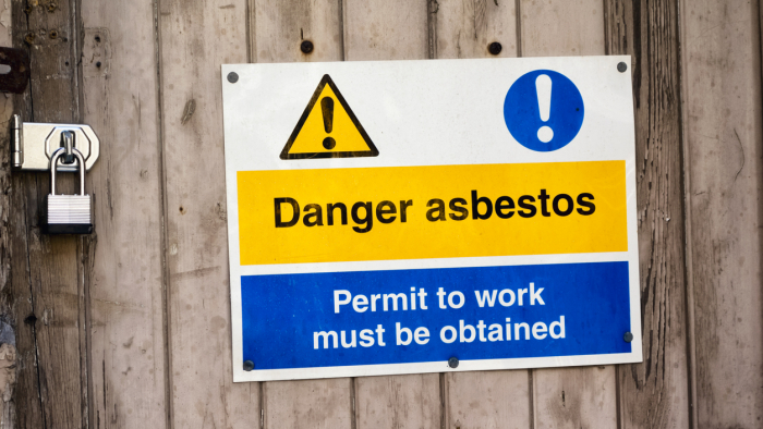 Danger asbestos - sign outside a derelict building