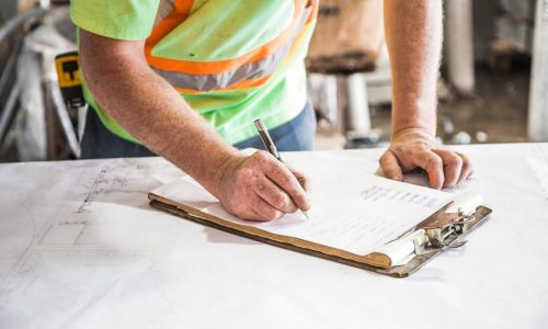 Construction worker filling out risk assessment form